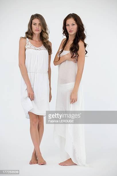 Portrait of two female friends posing