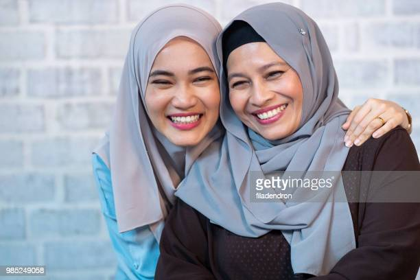 portrait of two female muslims - malaysia beautiful girl stock photos and pictures