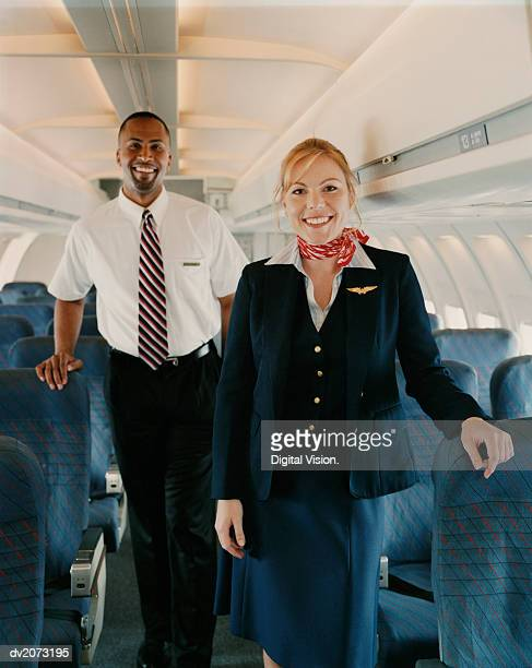 Portrait of Two Flight Attendants Standing in the Cabin of a Plane