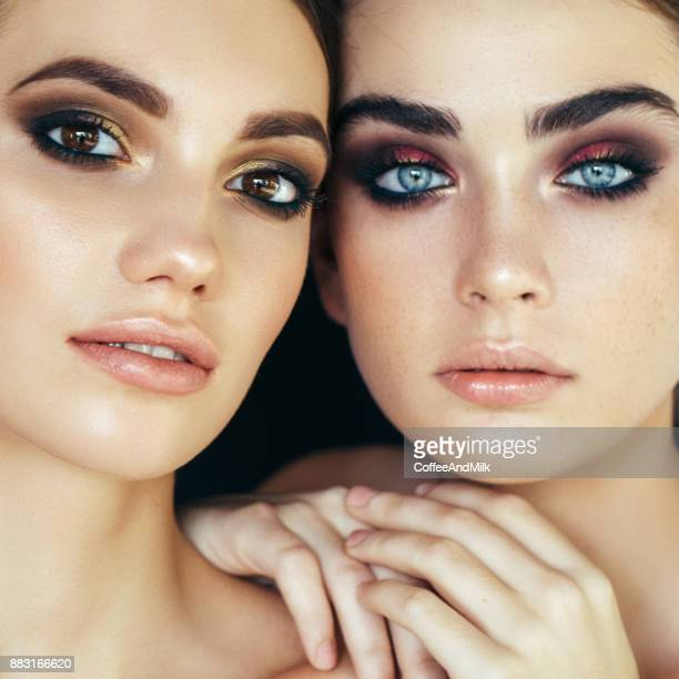portrait of two fresh and lovely women - eye make up stock pictures, royalty-free photos & images