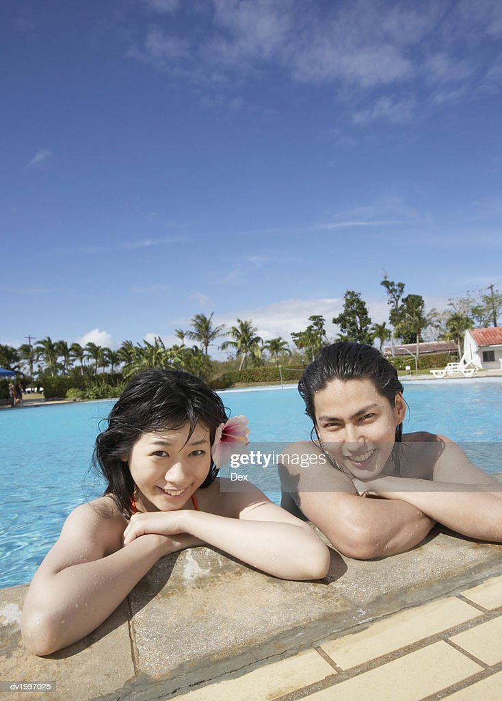 Portrait of Two Friends in a Swimming Pool : Stock Photo