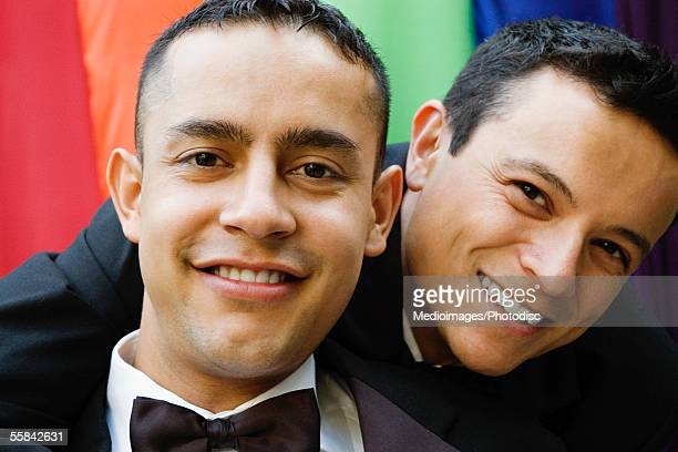 Portrait of two gay men in tuxedos, close-up