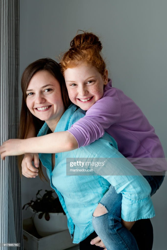 Portrait of two generations sisters. : Stock Photo