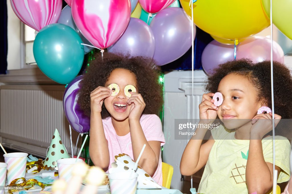 Portrait of two girls at a party : Stock Photo