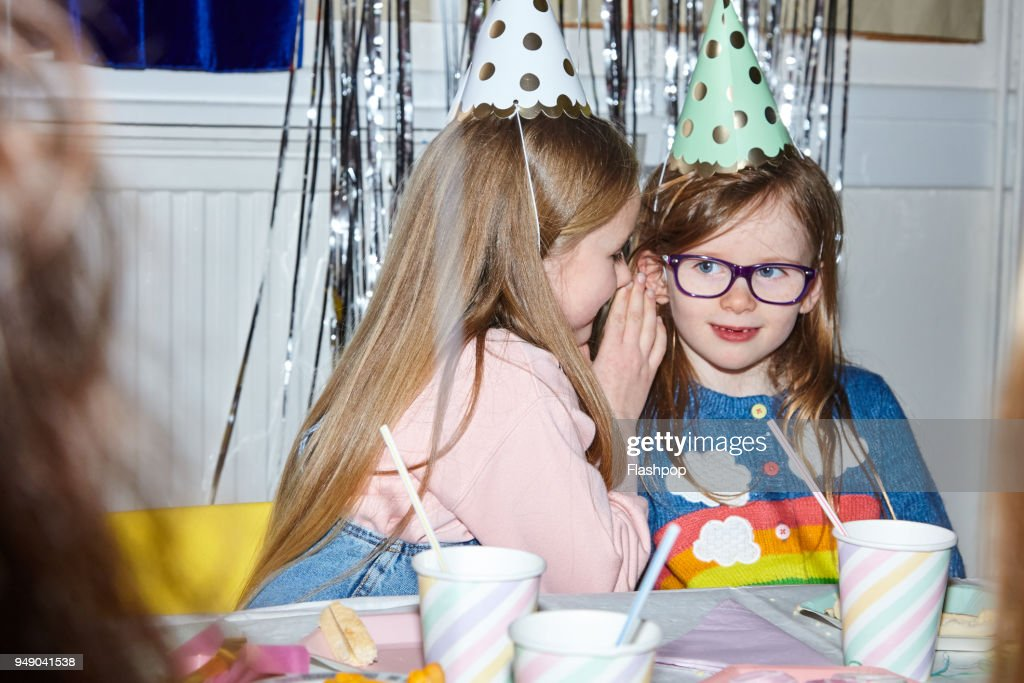 Portrait of two girls having fun at a party : Stock Photo