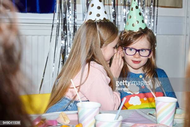 portrait of two girls having fun at a party - childhood stock pictures, royalty-free photos & images
