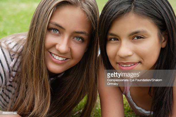 "portrait of two girls - ""compassionate eye"" stock pictures, royalty-free photos & images"