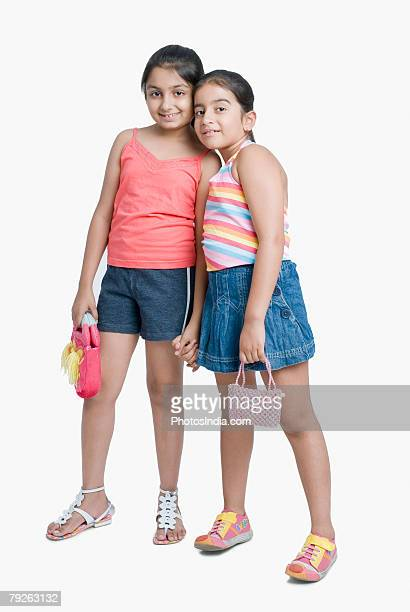 portrait of two girls standing together and smiling - girls with short skirts - fotografias e filmes do acervo