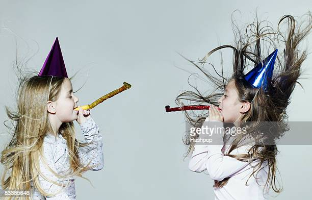 Portrait of two girls wearing party hats