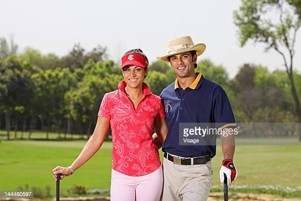 portrait of two golfers - sun hat stock pictures, royalty-free photos & images