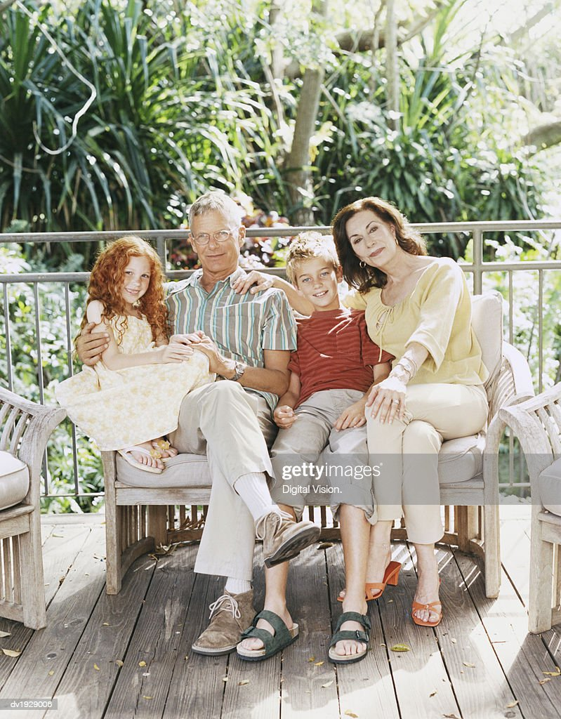 Portrait of Two Grandparents With Their Grandchildren : Stock Photo