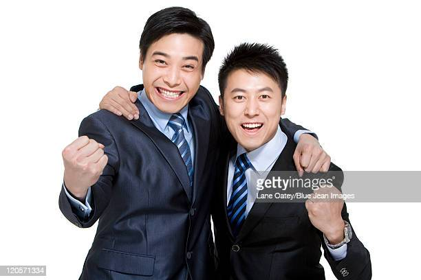 Portrait of two happy businessmen