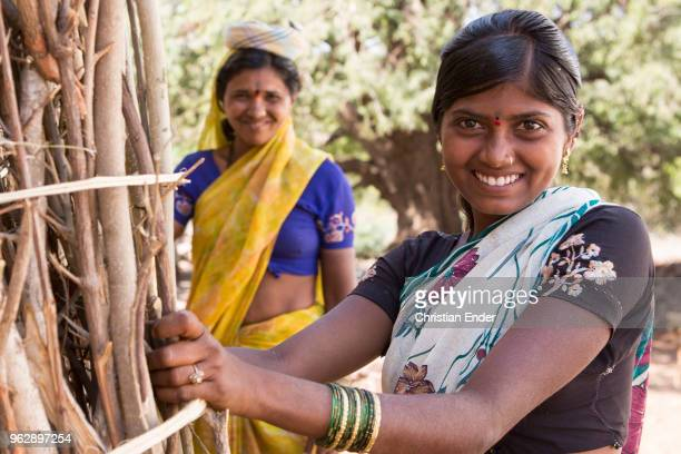 A portrait of two Hindu women who are collecting firewood In many rural areas there is no luxury like gas installation or transmission The young...