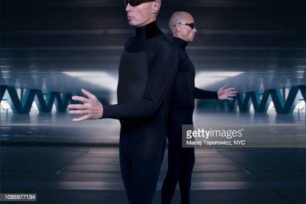 portrait of two identical man against futuristic background. - science fiction film stock pictures, royalty-free photos & images