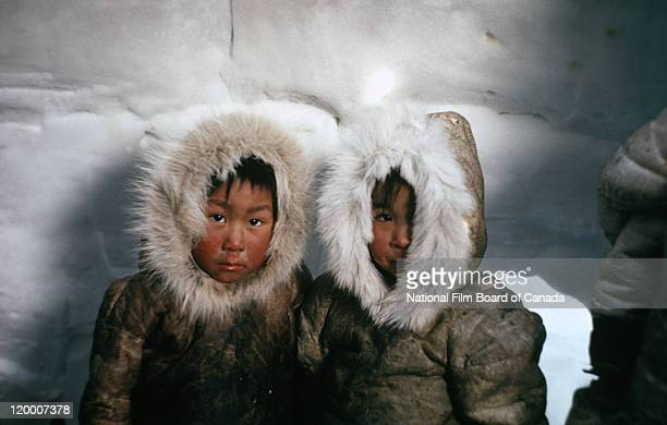Portrait of two Inuit children inside an igloo Nunavut Canada 1967 Photo taken during the National Film Board of Canada's production of 'The Netsilik...