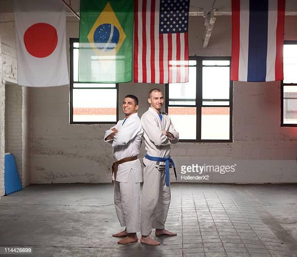 Portrait of two Jiu-Jitsu artists in uniform.