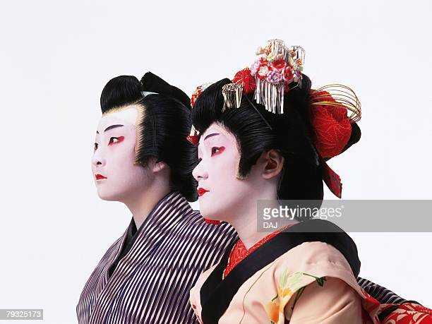 Portrait of two Kabuki actors, one acting as female, Side View