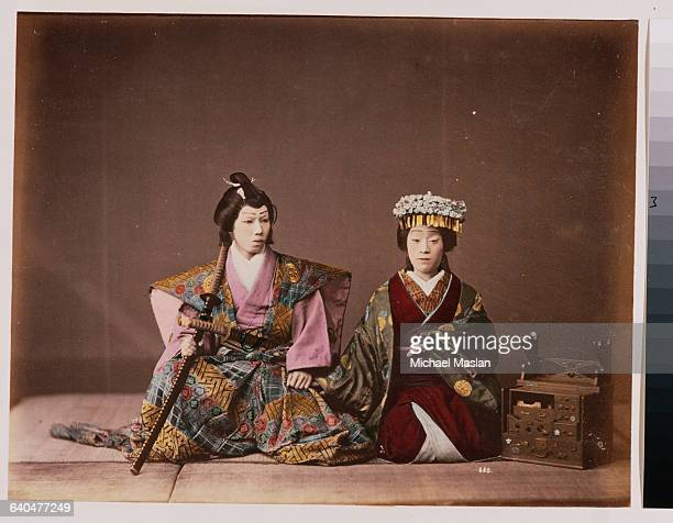A portrait of two Kabuki actors One portrays a woman while the other portrays a samurai Japan ca 1890s