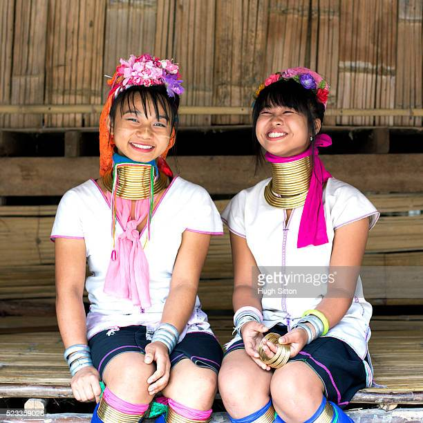 portrait of two local traditionally-dressed women, chiang mai, thailand - hugh sitton stock pictures, royalty-free photos & images