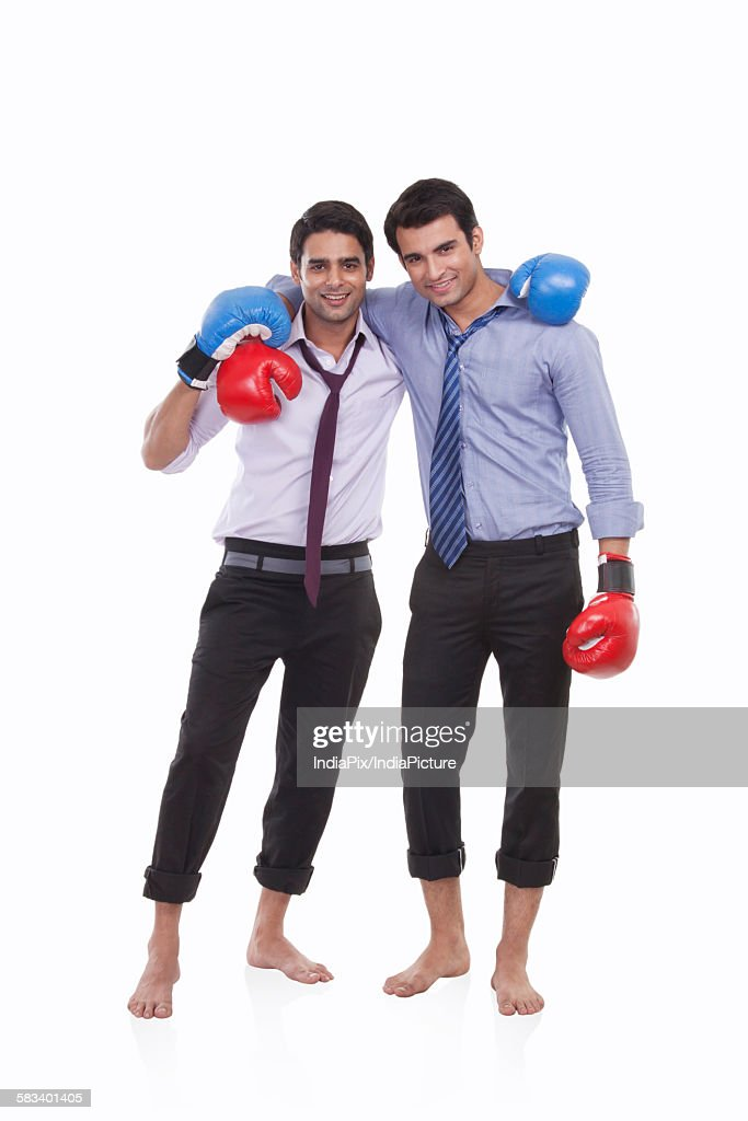 Portrait of two male executives with boxing gloves : Stock Photo