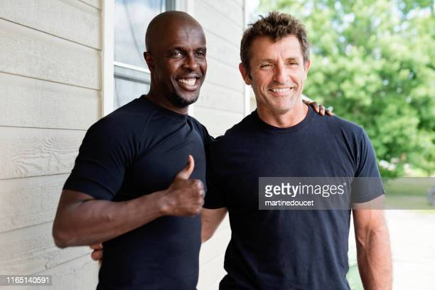 portrait of two mature men in summer. - black shirt stock pictures, royalty-free photos & images