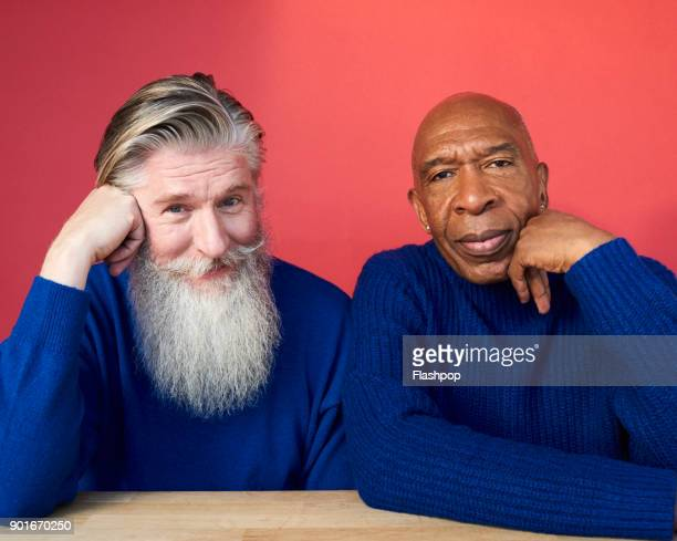 portrait of two mature men - gegensatz stock-fotos und bilder