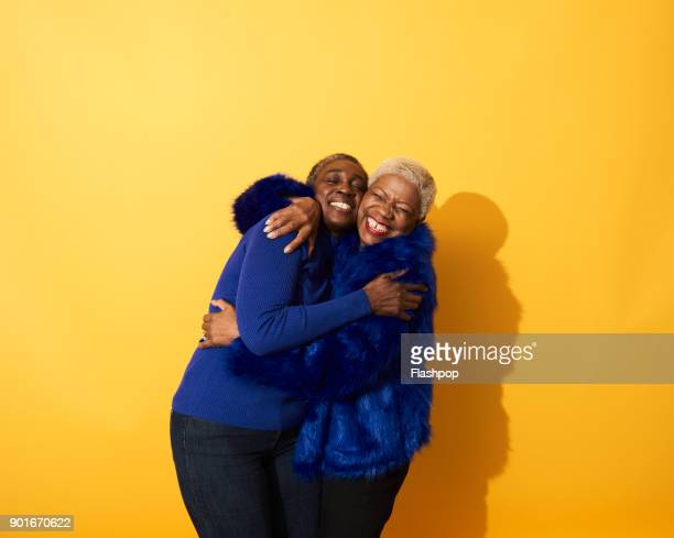 portrait of two mature women dancing and having fun together - embracing stock pictures, royalty-free photos & images