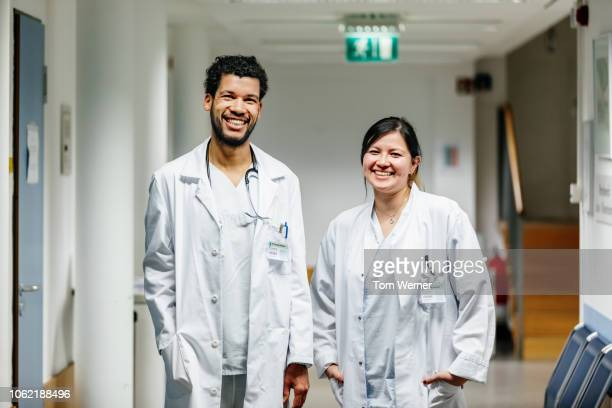 portrait of two medical students - laborkittel stock-fotos und bilder