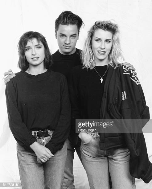 Portrait of two members of the pop group 'Bananarama' and musician Nick Kamen as they help make the charity single 'Let It Be' for the Zeebrugge...