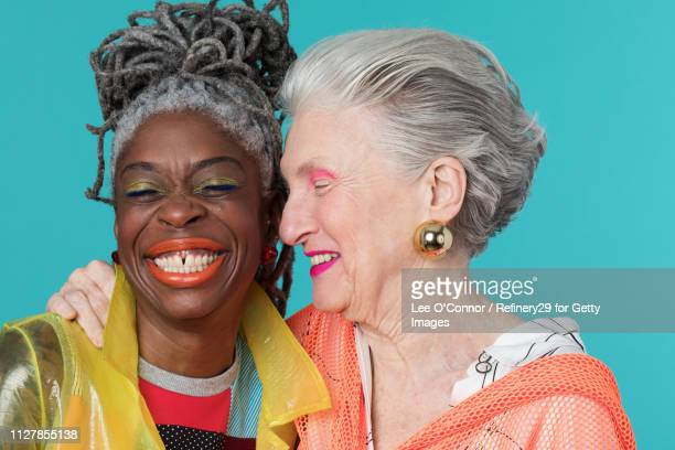 portrait of two older confident women smiling - noapologiescollection stock pictures, royalty-free photos & images