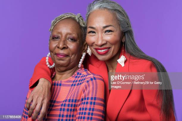 portrait of two older confident women smiling - noapologiescollection stock photos and pictures