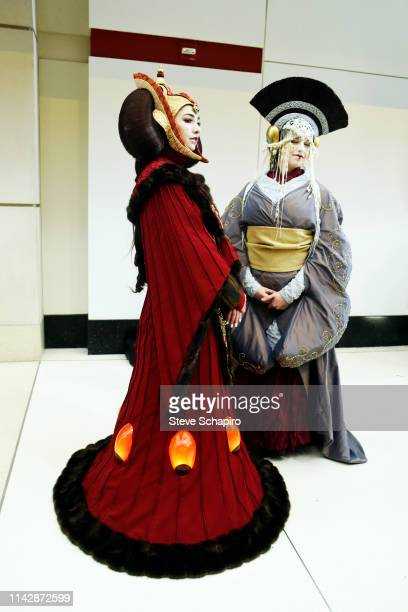 Portrait of two people, both dressed as 'Padme Amidala,' at the Star Wars Celebration event at Wintrust Arena, Chicago, Illinois, April 13, 2019.