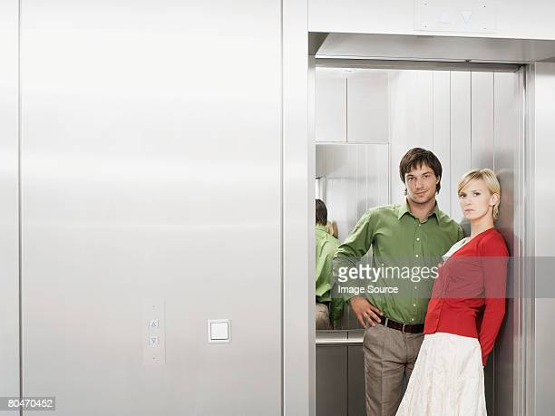 Portrait of two people in the lift