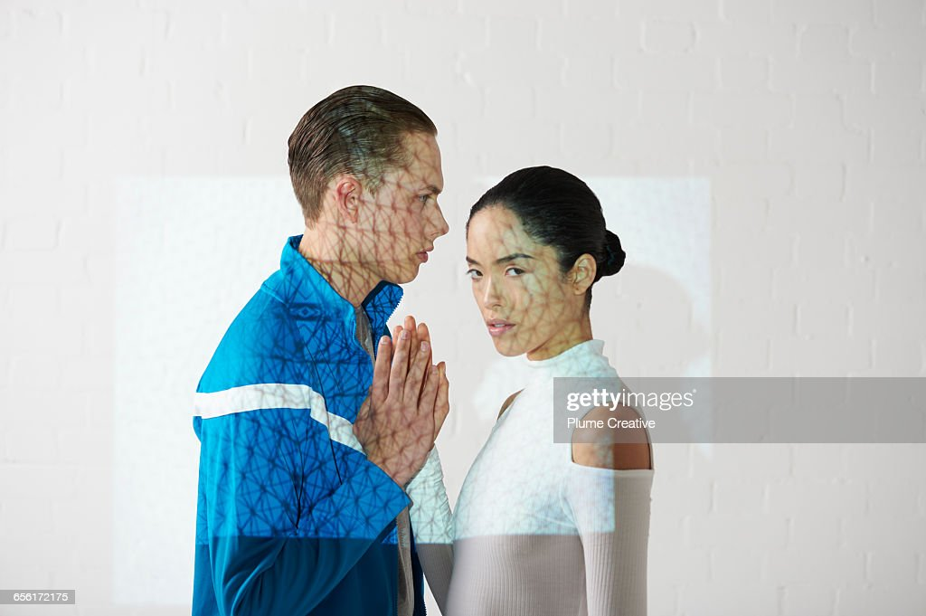 Portrait of two people with hands together