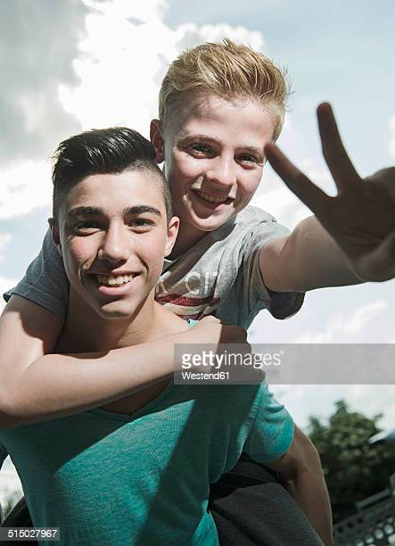 Portrait of two playful boys outdoors