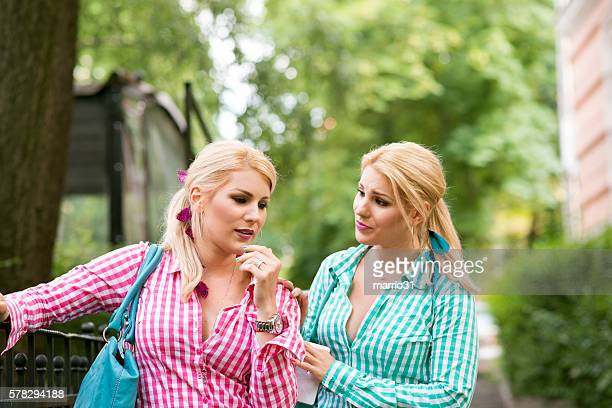 Portrait of two sad girls