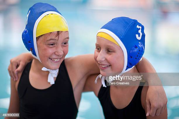 Portrait of two schoolgirl water polo players