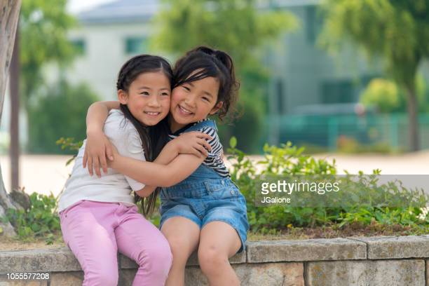 Portrait of two sisters hugging