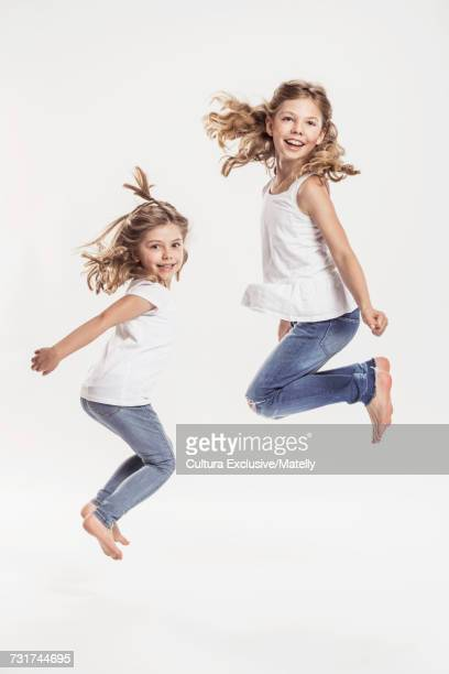 Portrait of two sisters, white background