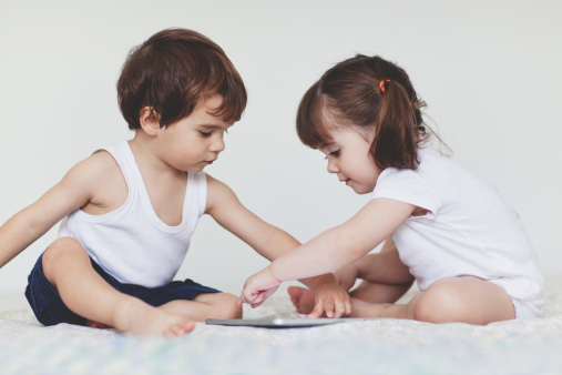 Portrait of two small kids looking a tablet - gettyimageskorea