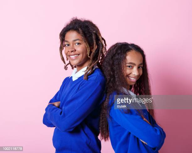 portrait of two smiling afro amercian teenage students - school uniform stock pictures, royalty-free photos & images