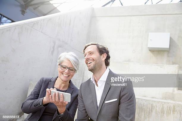 Portrait of two smiling business people