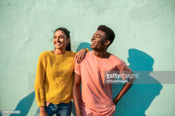 portrait of two smiling couple looking away. - fun stock pictures, royalty-free photos & images