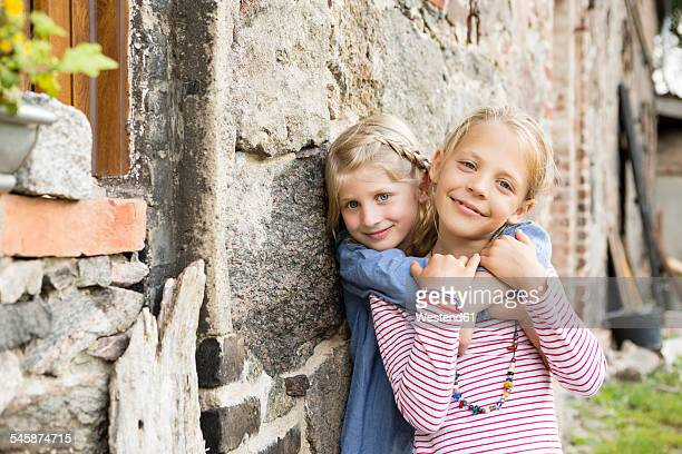 Portrait of two smiling little girls