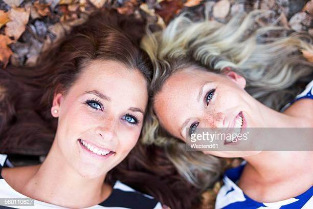 Portrait of two smiling women head to head