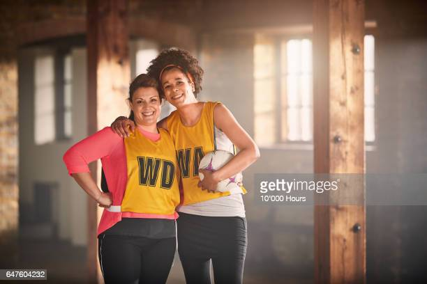 Portrait of two smiling women in gym.