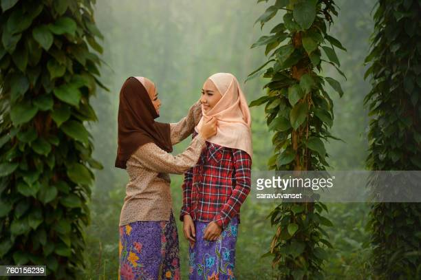 Portrait of two smiling women wearing traditional hijabs