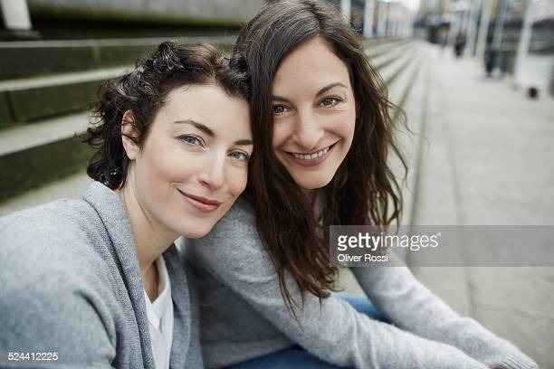 Portrait of two smiling young women outdoors