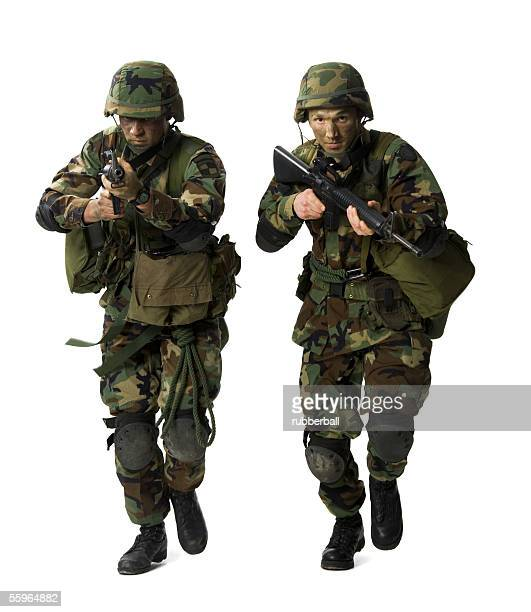portrait of two soldiers aiming their rifles - boots rifle helmet stock pictures, royalty-free photos & images