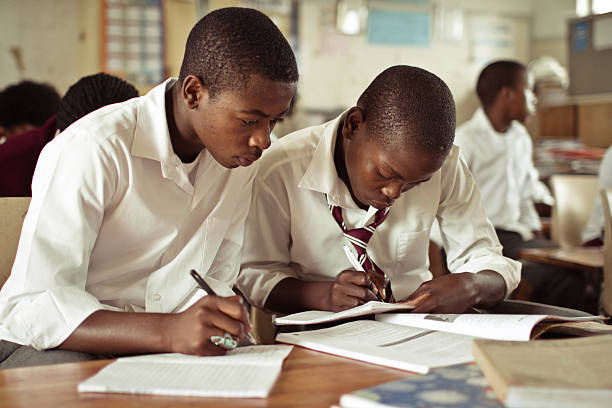 portrait of two south african boys studying in rural classroom picture id182028838?k=20&m=182028838&s=612x612&w=0&h=avqKF0zQ37eafIO1K